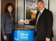 Pacific Building MD Brian Gallacher gives cheque to Nicola Hanssen, of ROAR