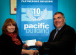 Fiona Scott, head of corporate development at Quarriers, receives a cheque from Pacific Building managing director Brian Gallacher