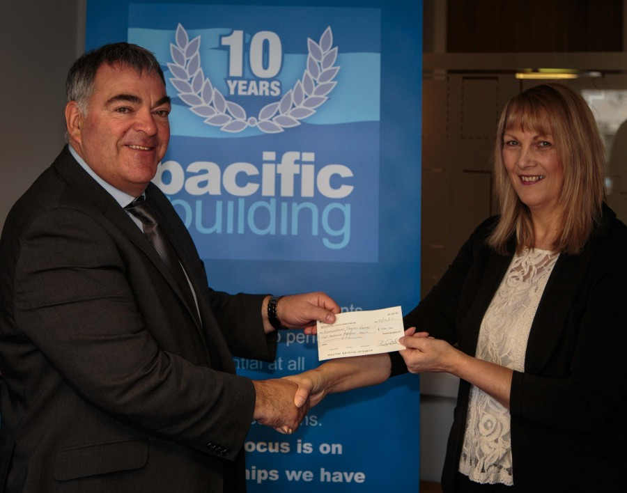 Diane Goodman of Renfrewshire Carers Centre with Brian Gallacher, Managing Director of Pacific Building Limited