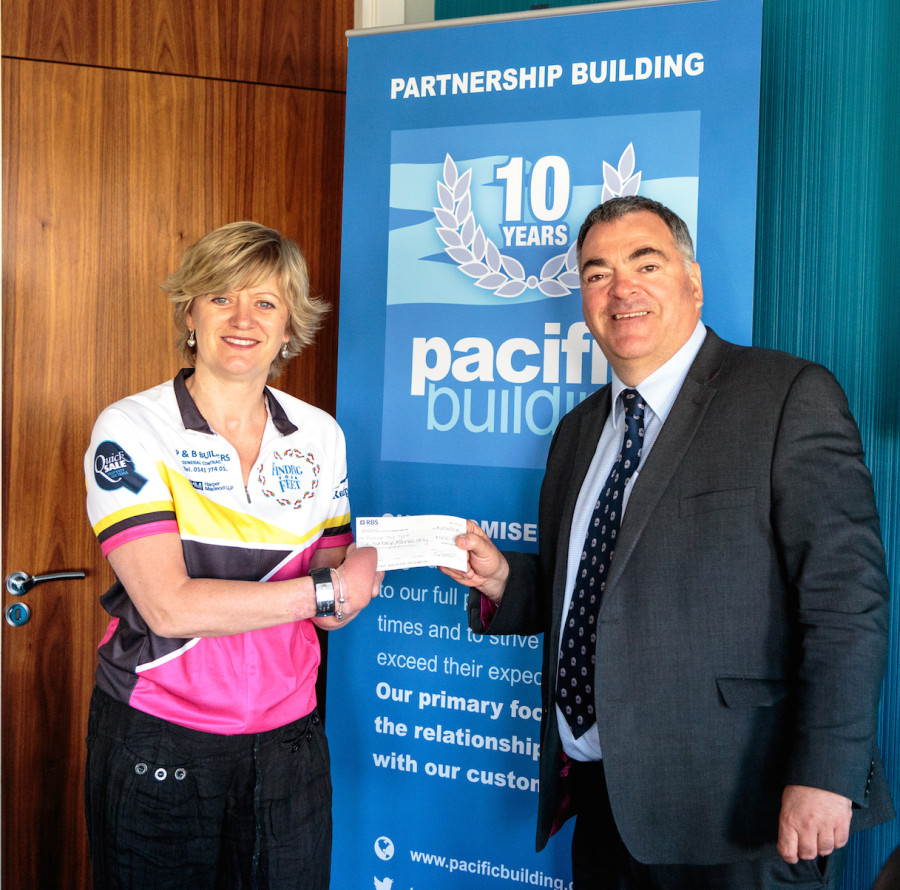 Quadruple amputee Corinne Hutton and Pacific Building Managing Director Brian Gallacher