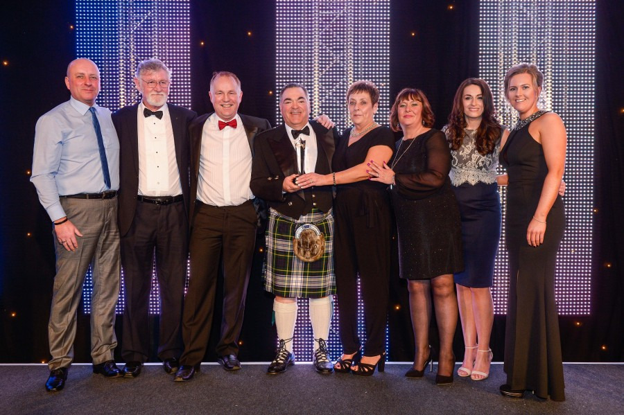 Pacific Building MD Brian Gallacher presents customer service award at Glasgow Airport staff awards