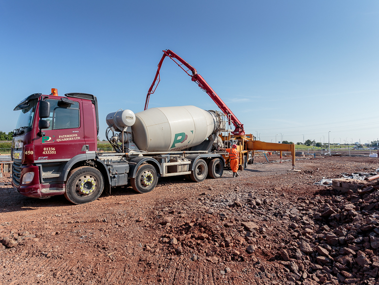 A total of 215 cubic metres – or 36 truck loads – of concrete have been poured on the site of the superbike village under construction by Pacific Building at Hillington Park. This will form the foundations of the showrooms and workshop facilities for West Coast Harley Davidson, Ducati Glasgow and Triumph Glasgow.
