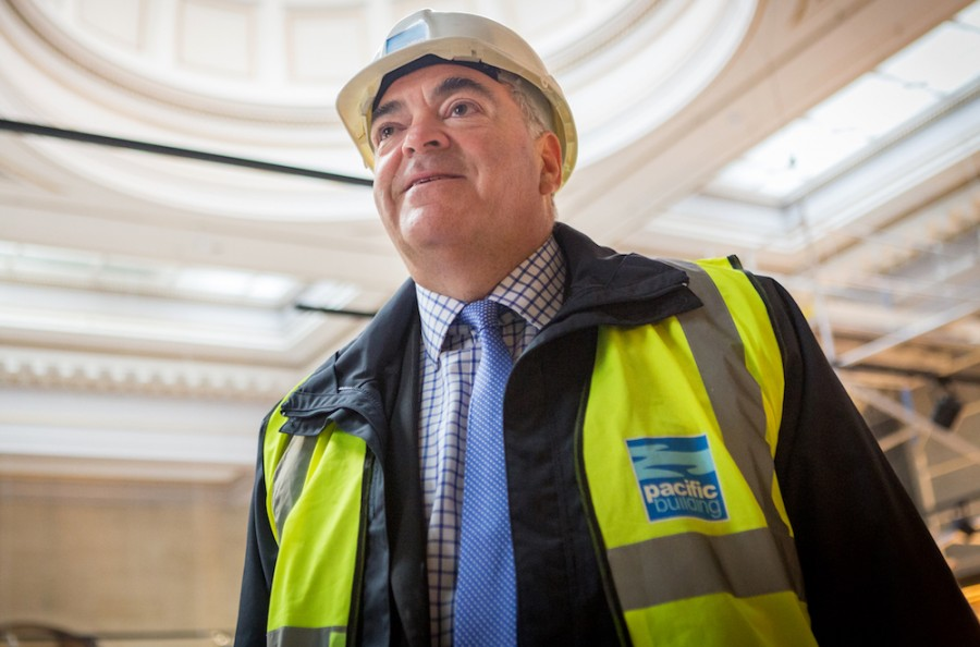 Brian Gallacher, MD, Pacific Building Ltd, wearing branded hard hat