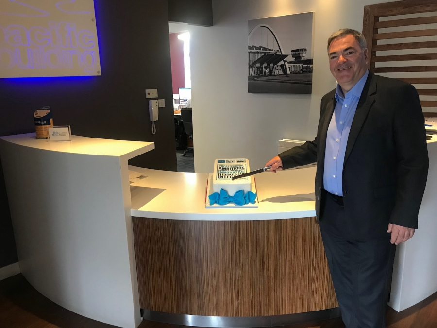Brian Gallacher Pacific Building MD slices cake